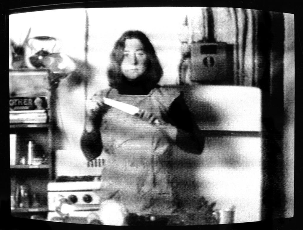 A still from Martha Rosler, groundbreaking 1975 video Semiotics of the Kitchen