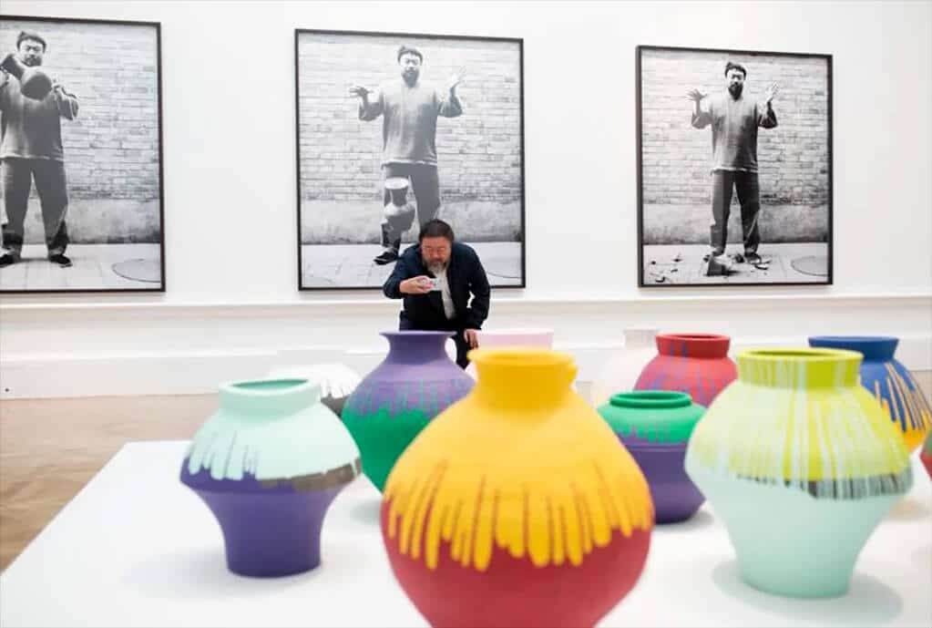 Ai Weiwei taking a photograph of his installation Coloured Vases, Royal Academy, 2015; © Dave Parry/courtesy of Royal Academy