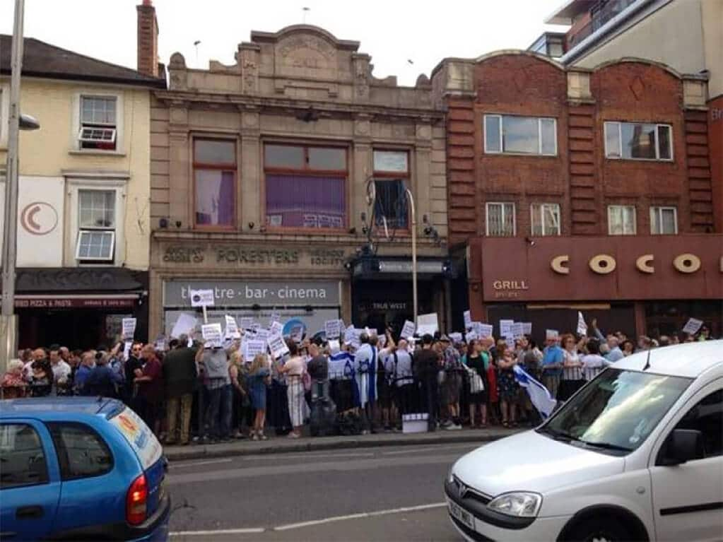 Protesters opposing the Tricycle's UKJFF decision outside The Tricycle Theatre in August 2014