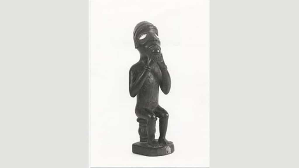 Seated Vili figure from Congo